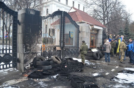 nationalists: KIEV, UKRAINE - February 2, 2015: Ukrainian nationalists of Battalion Aydar burn out ukrainian state simbol during protest against president Poroshenko.The gate of the Ministry of Defence.