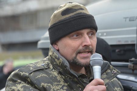 battalion: KIEV, UKRAINE - February 2, 2015: Ukrainian nationalists of Battalion Aydar burn out ukrainian state simbol during protest against president Poroshenko.The gate of the Ministry of Defence.