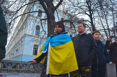 minister of war: KIEV, UKRAINE - February 2, 2015: Ukrainian nationalists of Battalion Aydar burn out ukrainian state simbol during protest against president Poroshenko.The gate of the Ministry of Defence.