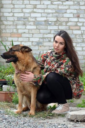 german girl: Teenager girl and German Shepherd dog