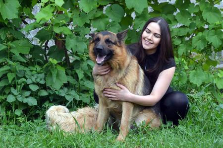 Teenager girl and German Shepherd dog