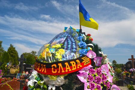 nationalist: AUG13,2015 in KIEV,UKRAINE .Lesnoye Forest Cemetery.Graves of Ukrainan army and nationalist formations soldiers died during Ukrainian Civil War 2014-15 at Donbas. At August 13,2015 in Kiev,Ukraine