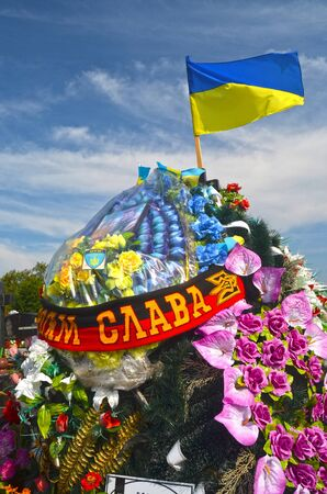 rapist: AUG13,2015 in KIEV,UKRAINE .Lesnoye Forest Cemetery.Graves of Ukrainan army and nationalist formations soldiers died during Ukrainian Civil War 2014-15 at Donbas. At August 13,2015 in Kiev,Ukraine