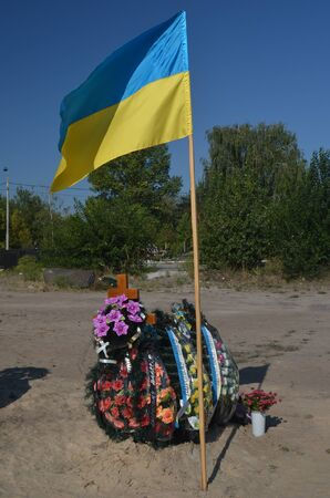 nationalist: AUG27,2015 in KIEV, UKRAINE .Lesnoye Forest Cemetery.Graves of Ukrainan army and nationalist formations soldiers died during Ukrainian Civil War 2014-15 at Donbas. At August 27,2015 in Kiev, Ukraine