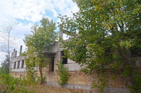 establishment states: Abandoned construction site of Hospital.Abandoned at 1991, during ukrainian undependence crisis. Near Kiev, Ukraine Stock Photo