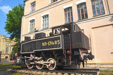 september 2: KIEV, UKRAINE - SEP 2, 2015: The monument of Soviet steam locomotive near Technical History Museum of National Polytechnic University on September 2, 2015 in Kiev, Ukraine Editorial
