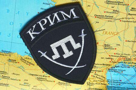 extremist: Kiev, Ukraine.NOV 13.Illustrative editorial. Chevron of Islamic extremist formation Crimea as part of Ukrainian Army.Background map November 13, 2015 in Kiev, Ukraine Editorial