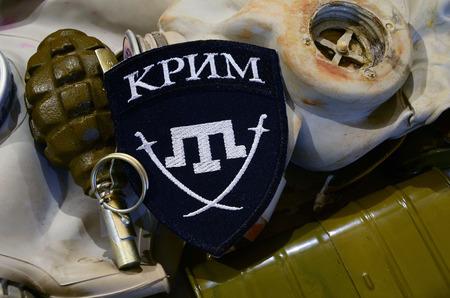 extremist: Kiev, Ukraine.NOV 23.Illustrative editorial. Chevron of Islamic extremist formation Crimea as part of Ukrainian Army.Background old gas mask. November 23, 2015 in Kiev, Ukraine