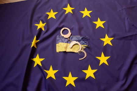 hand cuff: Partnership. EU and UA Flag