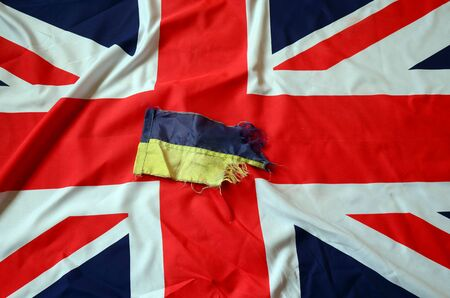 hand cuff: Partnership. Britain and Ukraine Flag Stock Photo