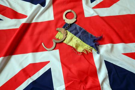 hand cuff: Partnership. Britain and Ukraine Flag Stock Photo