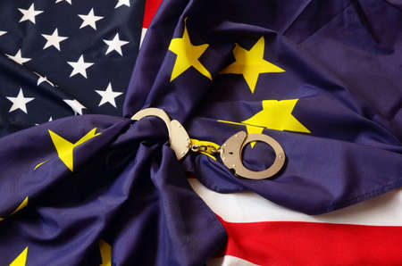 hand cuff: Partnership. USA and EU Flag Stock Photo
