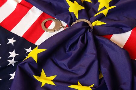 hand cuff: Partnership. USA and EU Flag Stock Photo
