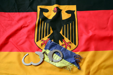 hand cuff: Partnership. Germany and Ukraine Flag