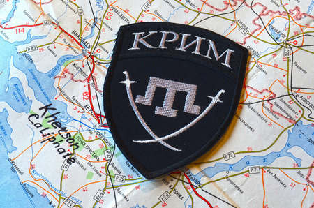 extremist: Kiev, Ukraine.FEB 20 ILLUSTRATIVE EDITORIAL.Chevron of Islamic extremist formation Crimea.Background map of Kherson Caliphate.At February 20,2016 in Kiev, Ukraine