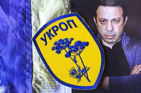 nazi flag: Kiev, Ukraine.FEB 20.ILLUSTRATIVE EDITORIAL.Chevron Ukrainian nazionalist battalion.Bakground - booklet of Urainian Patriot Organisation leader G.Korban.February 20,2016 in Kiev, Ukraine