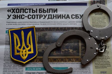 stolen: Chevron Ukrainian nazionalist battalion.Background - newspaper about West Frisian stolen art