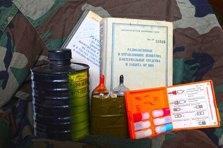 chemical warfare: Vintage Soviet chemical and nuclear warfare protection items.Secret military literature of 1960-th Editorial