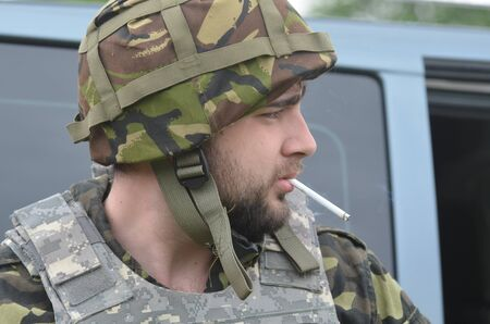 battalion: An unidentified person wears modern Ukrainian nazionalist battalion uniform Editorial