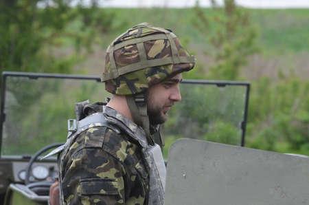 battalion: An unidentified person wears modern Ukrainian nazionalist battalion uniform Editorial
