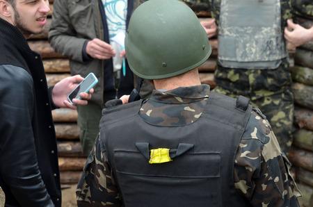 batallon: An unidentified person wears modern Ukrainian nazionalist battalion uniform Editorial