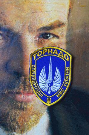 creator: Chevron of Ukrainian nazionalist battalion. Background-Vladimir Lenin, the creator of Ukraine.