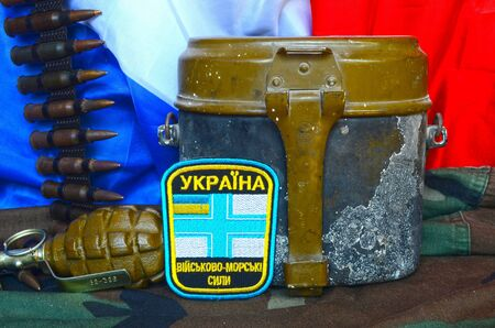 agression: Chevron of Ukrainian army.Netherlands Flag as background.Ukraine protect the World from Russian agression