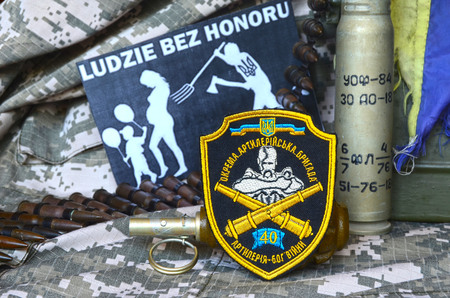 Chevron of Ukrainian army.Background - Polish anti-ukrainian poster.Civil War in Ukraine Editorial
