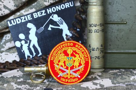 troop: Chevron of Ukrainian army.Background - Polish anti-ukrainian poster.Civil War in Ukraine Editorial