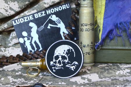 illustrative editorial: Chevron of Ukrainian army.Background - Polish anti-ukrainian poster.Civil War in Ukraine Editorial