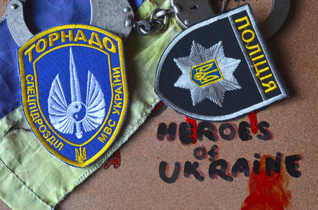 batall�n: Chevron of Ukrainian battalion Tornado in Police.The battalion disbanded for pederastic rapes kids, marauding and torture.
