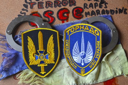 batallón: Chevron of Ukrainian battalion Tornado in Police.The battalion disbanded for pederastic rapes kids, marauding and torture.