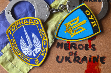 batallón: Chevron of Ukrainian SPECIAL chastener battalion Tornado in Police.The battalion disbanded for pederastic rapes kids, marauding and torture Editorial