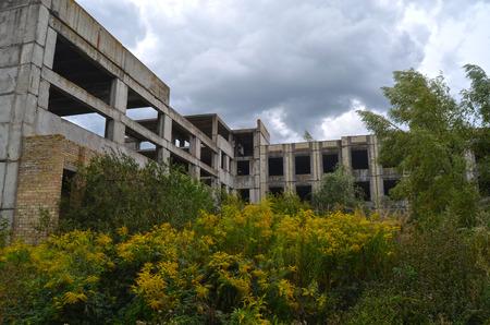 Abandoned Soviet school building construction site.Abandoned at 1991, during ukrainian undependence crisis.August 24, 2017.Near Kiev, Ukraine Editorial