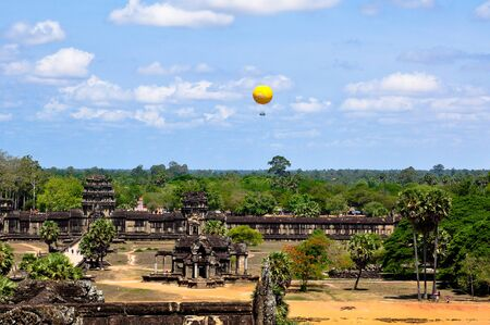 Hot air balloon above Angkor Wat, Cambodia. Rise on it will help you to see the ancient city from the bird-fly level. Redakční