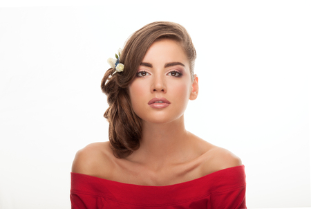 low blouse: Young adorable brunette woman in red blouse with trendy makeup and low bun hairstyle