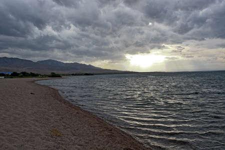issyk kul: Cloudy weather on the nice lake Issyk kul Stock Photo