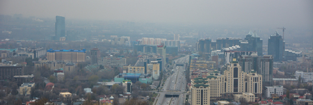 Blured view of Almaty skyline.