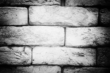 Old black and white brick texture background. Grunge stones. Banco de Imagens
