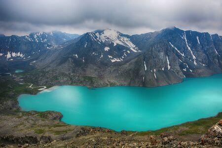 Wonderful mountain landscape (lake, highland, peak, beauty world) Picturesque view near Alakul lake in Terskey Alatoo mountains, Tian-Shan, Karakol, Kyrgyzstan