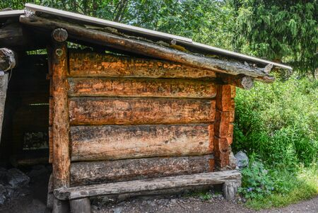 Close up cabine in the forest. Old wood shelter from rain.