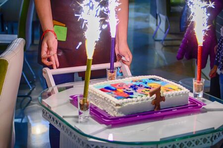 Birthday cake with bright candles. Kid party.