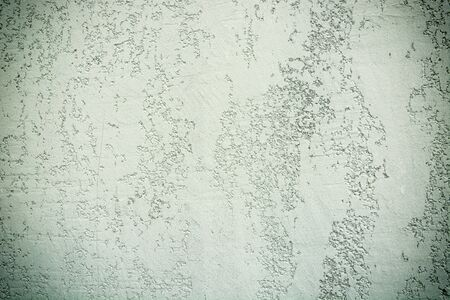 Light green or grey grungy concrete wall texture. Stone surface pattern. Gradient wallpaper shape. Backdrop have copy space for text.