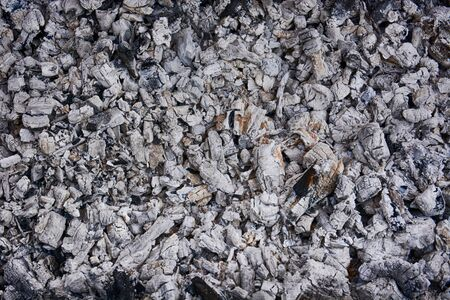 Natural gray coals for background. Close up creative carbon ashes texture.