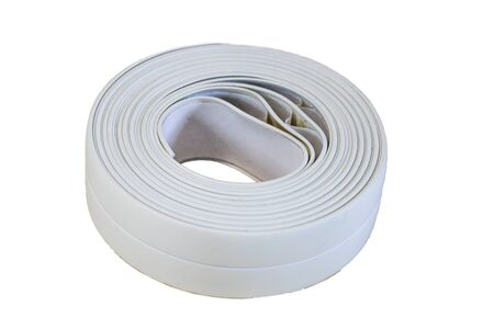 Bath tape. Roll of white adhesive flexible caulk strip isolated on white. Archivio Fotografico - 139385268