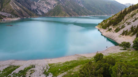 Beautiful mountain turquoise color lake Karasuu in Tian-Shan, Kyrgyzstan. Arial view. Soft focus. Blurred.