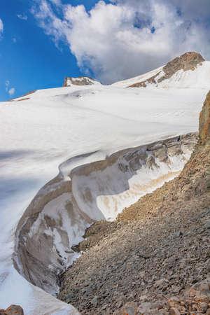 Glacier in mountains Glacier ice close up. Blue arctic ice. Kyrgyzstan. Archivio Fotografico - 155358577