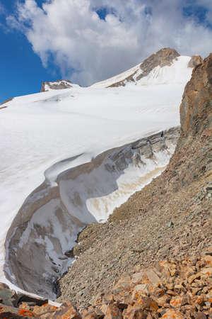 Glacier in mountains Glacier ice close up. Blue arctic ice. Kyrgyzstan.