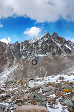 Weather station in mountains. Rocks, snow and stones in mountain valley view. Mountain panorama. Archivio Fotografico - 156197381