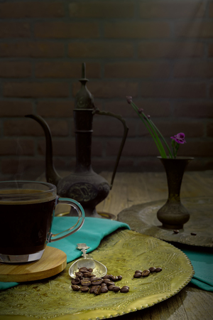 A cup of coffee and coffee beans i on an old copper tray, say good morning Stok Fotoğraf